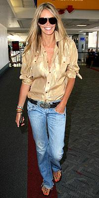 Elle MacPherson, straight jeans, nude shirt, sunglasses