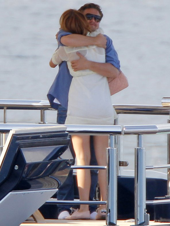 Blake Lively and Leonardo di Caprio hugging on a boat, 2011