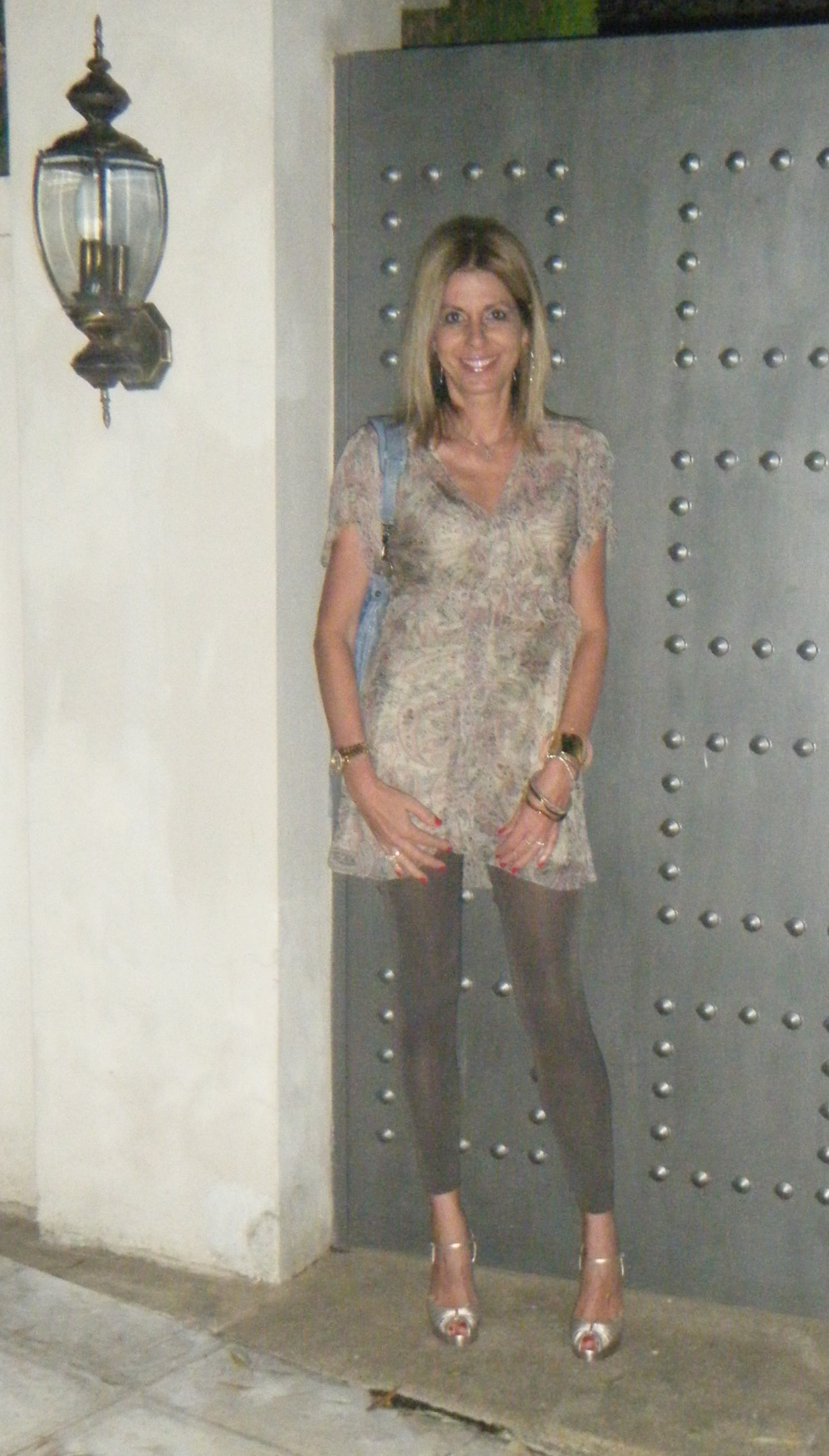 Nina Papaioannou, Gold Christian Louboutin shoes, with a juicy dress and Falke leggings