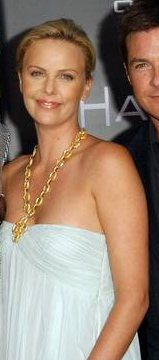 Charlize Theron wearing Ilias Lalaounis Gold Jewelry