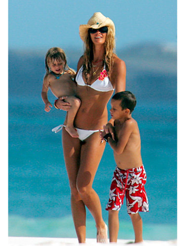 Elle Macpherson, bikini body, beach, kids, hat,sunglasses, white bikini